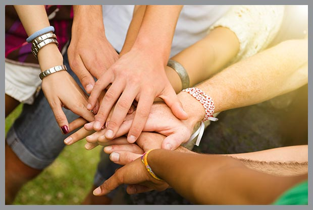 hands in a group representing our programs for runaway and homeless youth mission and values